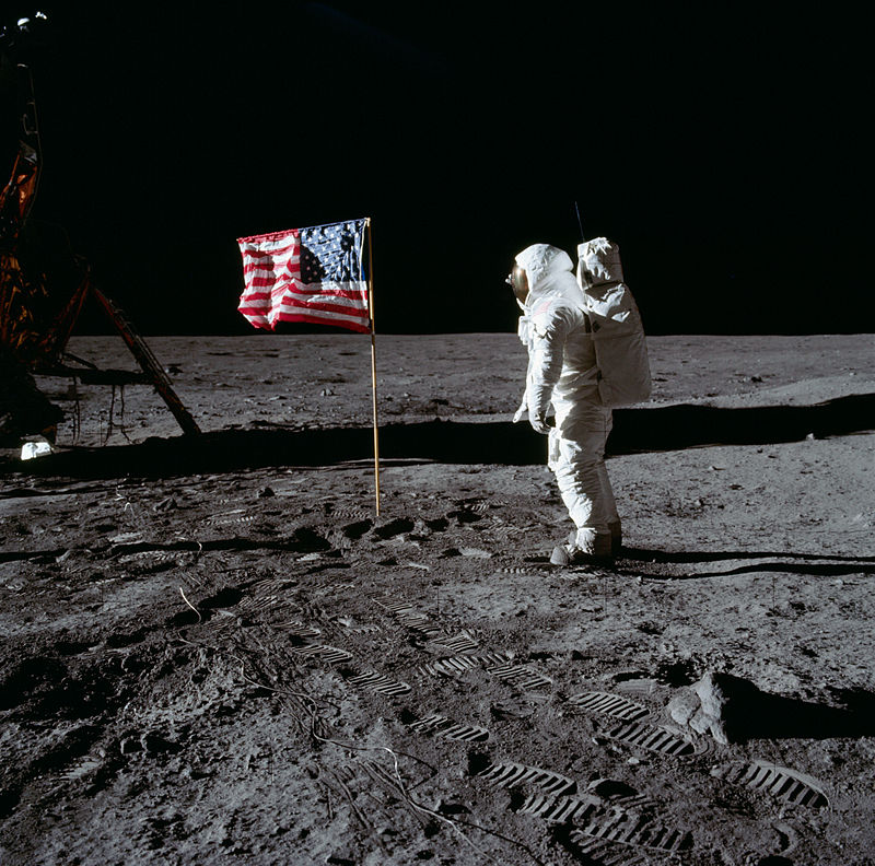 Astronaut Buzz Aldrin salutes the deployed United States flag during an Apollo 11 Extravehicular Activity (EVA) on the lunar surface. Photo taken by astronaut Neil Armstrong