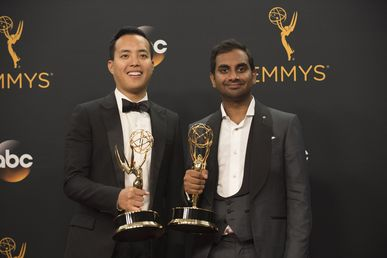 Alan Yang and Aziz Ansari pose for photographers after winning their Emmys