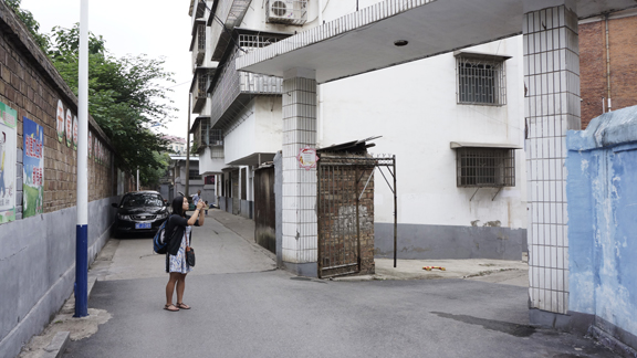 Olivia Wolf photographs the gate where she was found abandoned