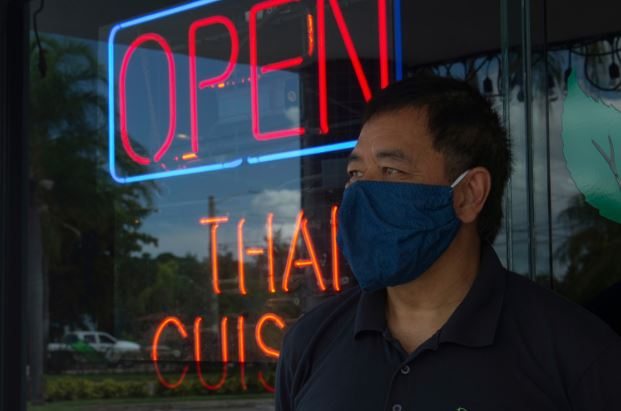 Family employee Poomchongkho Thaleangwong stands in front of the Pepermint Thai in Palm Beach, FL