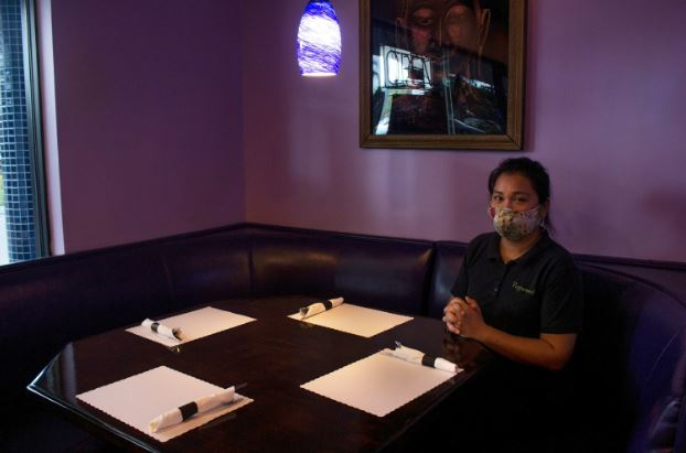 Family employee Tammi Nitibhon relaxes at the Peppermint Thai in Palm Beach, Florida