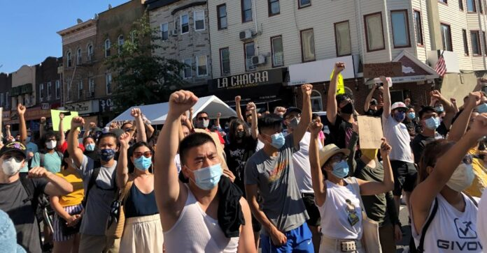 Protesters raise fists at Asian Unity Rally in Brooklyn