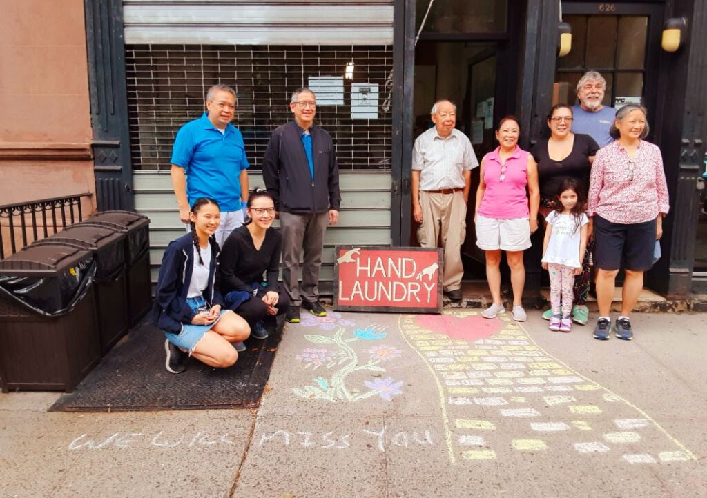 """A chalk drawing says it all in front of Sun Laundry: """"We will miss you."""" Photo by Corky Lee"""