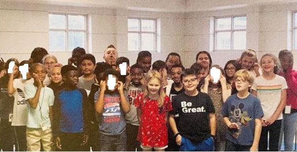 asamnews.com: Grade school kids make slant eye gesture in yearbook photo – AsAmNews