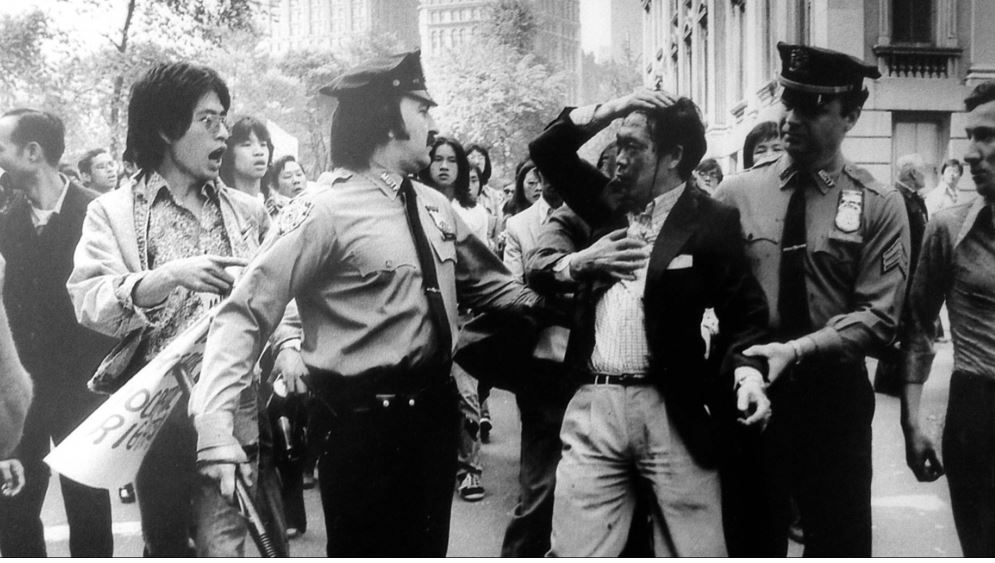 The arrest of a bloodied Chinese American during a police brutality protest at New York City in 1975.